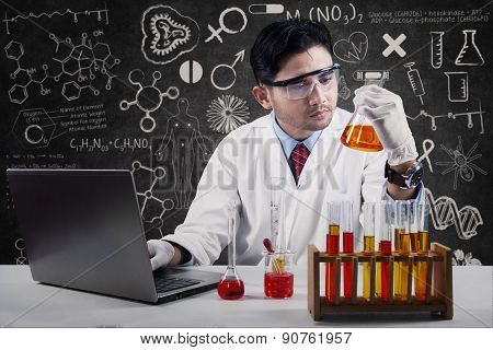 Scientist Looking At The Reaction Of Chemistry