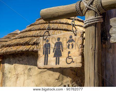 Wooden washroom sign