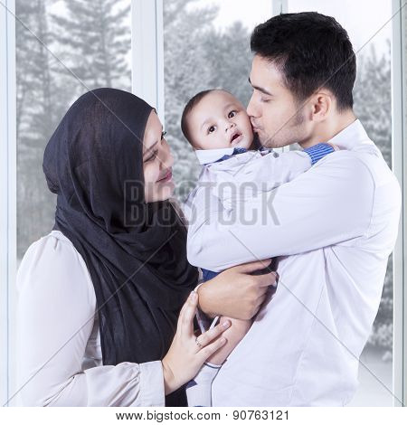 Two Parents With Their Male Baby