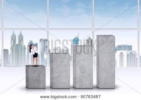 Woman Standing On A Multilevel Graph