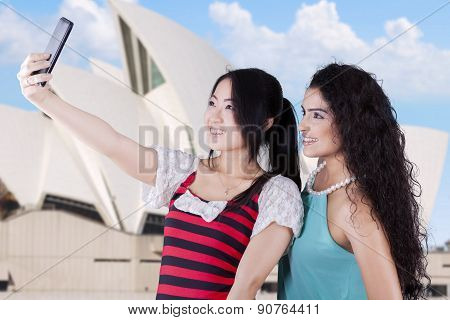 Young Girls Taking A Selfie At Opera House