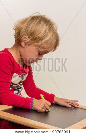 a child with a blank blackboard.