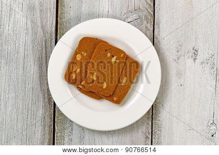 Wafer Shaped Cookies In Plate On Aged White Wood
