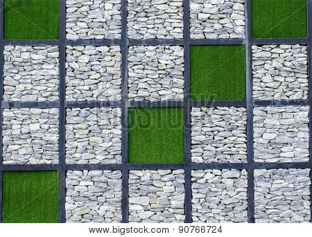 Stone walls and artificial grass