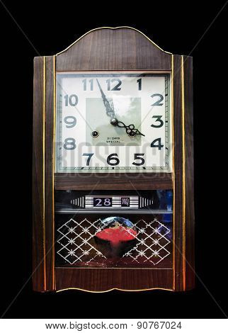 Antique wooden clock isolate on black background