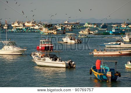 Ocean view with anchored boats in the coast of Manta, Ecuador