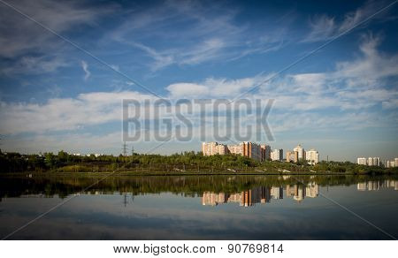 Multi-storey Buildings Are Reflected  In The River