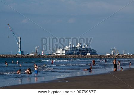 Beautiful landscape of Manta beach with a luxury cruise in the background, Ecuador