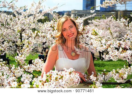 Beautiful Female Posing In The Sakura Garden