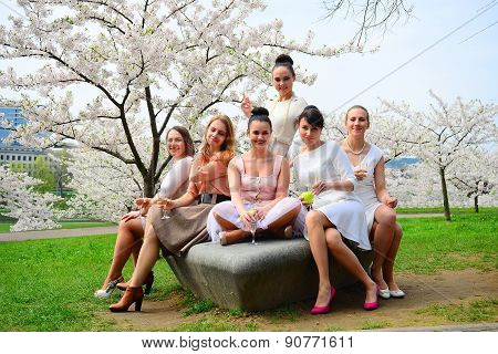 Girls With Champagne Celebrating In Sakura's Garden.