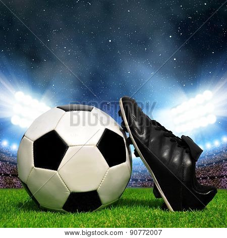 Soccer ball and shoes in grass