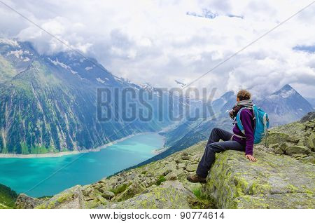 Alpine landscape, young woman and lake, Austria