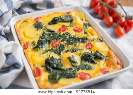 Fritatta with spinach and tomatos