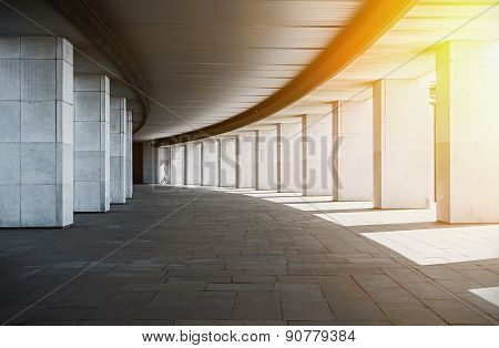 Long Corridor With Columns At Sunset