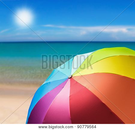 Colorful Umbrella On The Beach Background