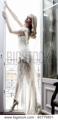 Beautiful Bride In Luxury Hotel Room With Wedding Dress