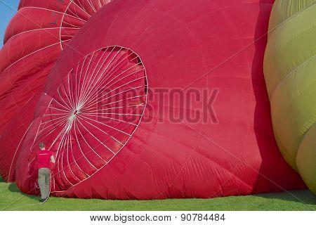 Man prepares hot air balloon for the flight in Vilnius, Lithuania.