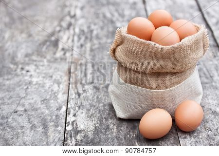 Sack Bag With Eggs On The Old Table