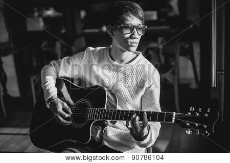 Asian Guitarist Artist Man Play Guitar In Cafe Monochrome