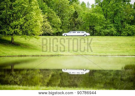 White Limo Reflecting In Lake