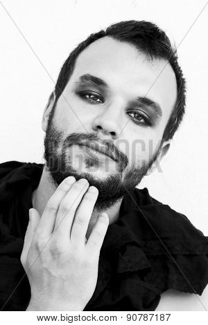 Portrait Of A Male Model With Smokey Eyes And Black Clothes. Black And White