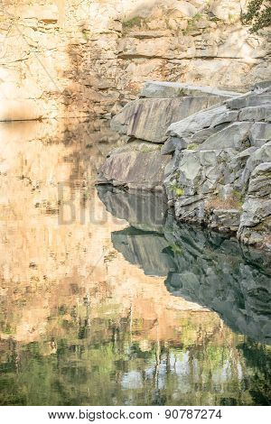 Stone And  Reflections At A Quarry