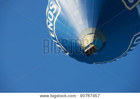 People fly with the hot air balloon in Vilnius, Lithuania.