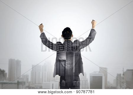 Double Exposure Of Business Man Raise His Hands