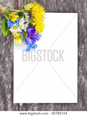 Wildflower Bouquet On The Oak Brown Table With White Sheet Of Paper