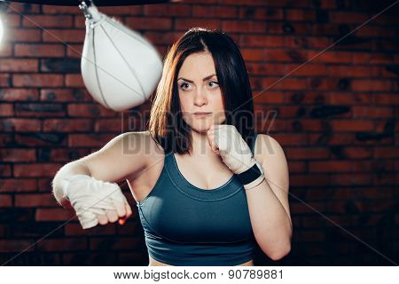 Young woman boxing workout on the gym
