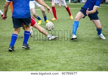 Legs Of Football Players In Action