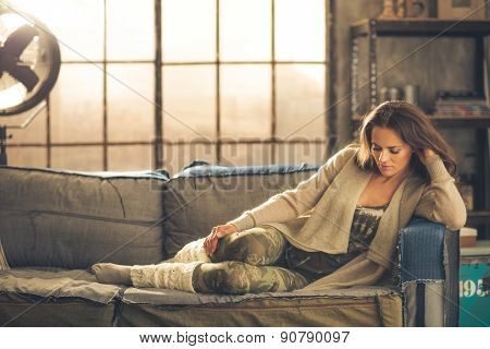 Woman Sitting Relaxing On A Sofa Dressed Comfortably