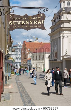 People walk by the street of the old town in Vilnius, Lithuania.