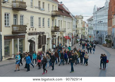 Tourists walk by the street of the old town in Vilnius, Lithuania.