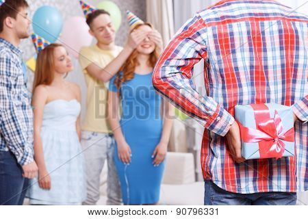 Young girls receiving presents at birthday party
