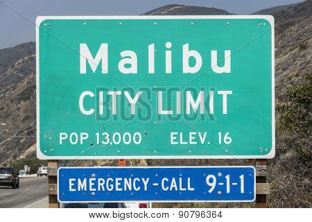 Malibu, California, USA - April 14, 2015:  Malibu city limit sign on busy Pacific Coast Highway in Southern California.