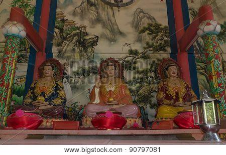 three chinese buddha statue