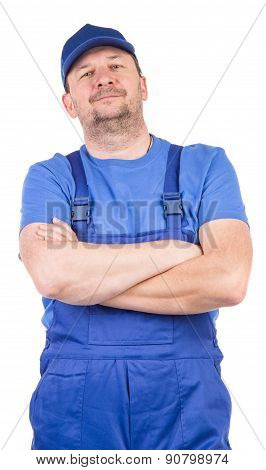 Worker in blue overalls.