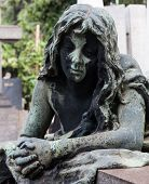 stock photo of cemetery  - More than 100 years old statue - JPG