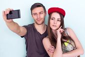 stock photo of casual wear  - two women and man friends taking selfie together wearing summer clothes  jeans shorts jeanswear street urban casual style having fun - JPG