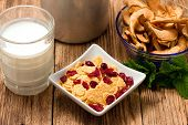image of fruit bowl  - Horizontal photo of modern square bowl full of cornflakes with fruit - JPG