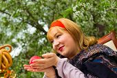 picture of curvaceous  - Beautiful Russian girl with a curvaceous rosy and happy sitting at a table with a samovar drying bagels budlikami strawberries in the spring blooming garden bright colors and spring - JPG