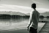 image of peaceful  - Handsome young man on a lake - JPG
