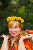 pic of flirty  - Cheeked Russian cheerful young woman in a wreath of fresh dandelion flirt flirty look - JPG