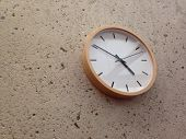 image of analogy  - Analog classical wall clock on a stone partition wall - JPG