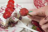 picture of whip-hand  - Homemade strawberry cake with whipped cream served on a plate - JPG