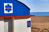 stock photo of sos  - SOS station handicapped accessible on the beach - JPG
