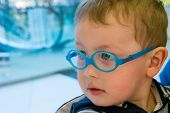 pic of attitude boy  - A little boy wearing glasses looks with a serious face - JPG