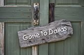 picture of redneck  - Gone to Dallas sign on old green door - JPG