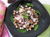 stock photo of aubergines  - Salad with fried aubergines chick peas and dates - JPG